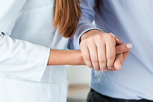 Image of individuals holding hands to support one another