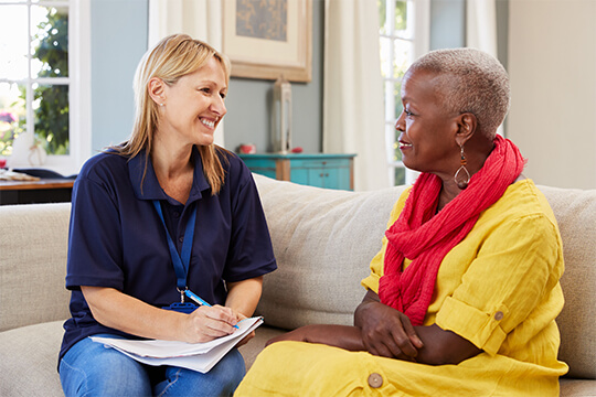 A career in care - carer talking to woman